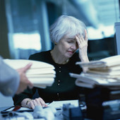 Woman at work looking overloaded