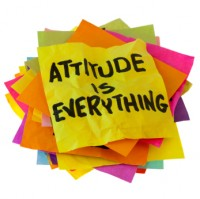 """Attitude is everything"" written on pile of post it notes"