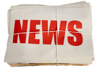 """Pile of papers with the word """"News"""" in bold red letters on top one."""