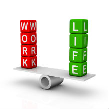 "The words ""work"" and ""life"" balancing on a scale"