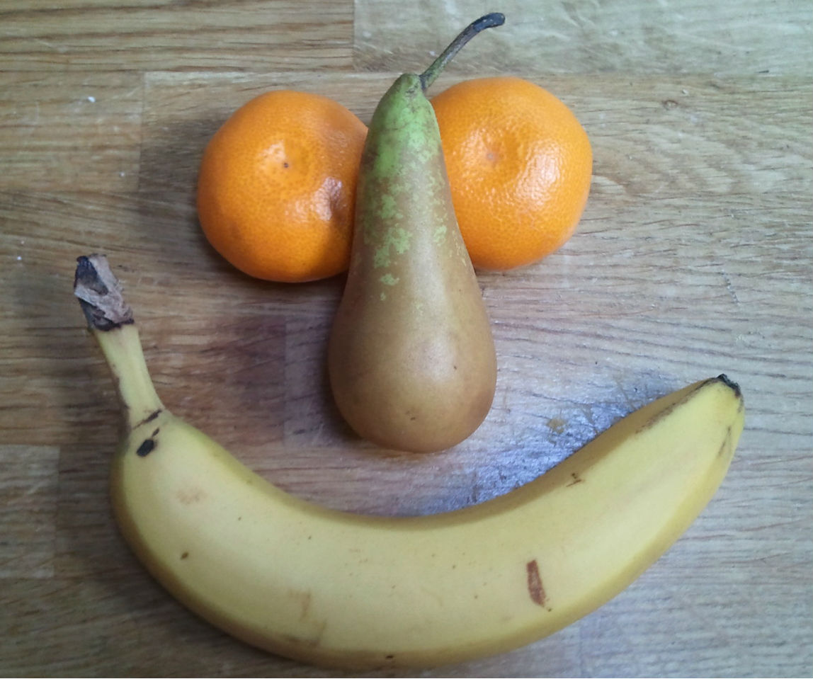 Fruit laid out like a happy face