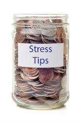 "Coin filled jar with ""Stress Tips"" on label"