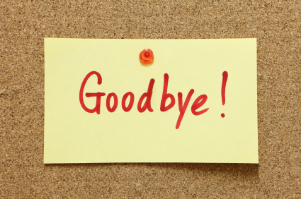"Post it note on pinboard with the word ""Goodbye"" written on it."