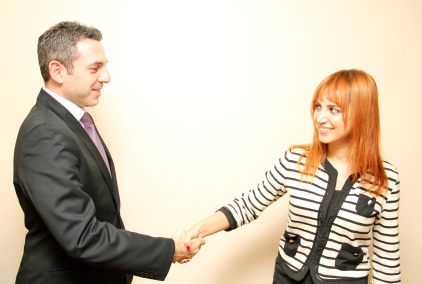 Conversation at work: Man and woman shaking hands