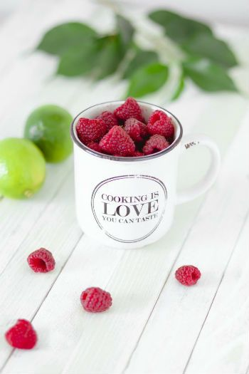"""Cooking is love you can taste"" Raspberries in mug"