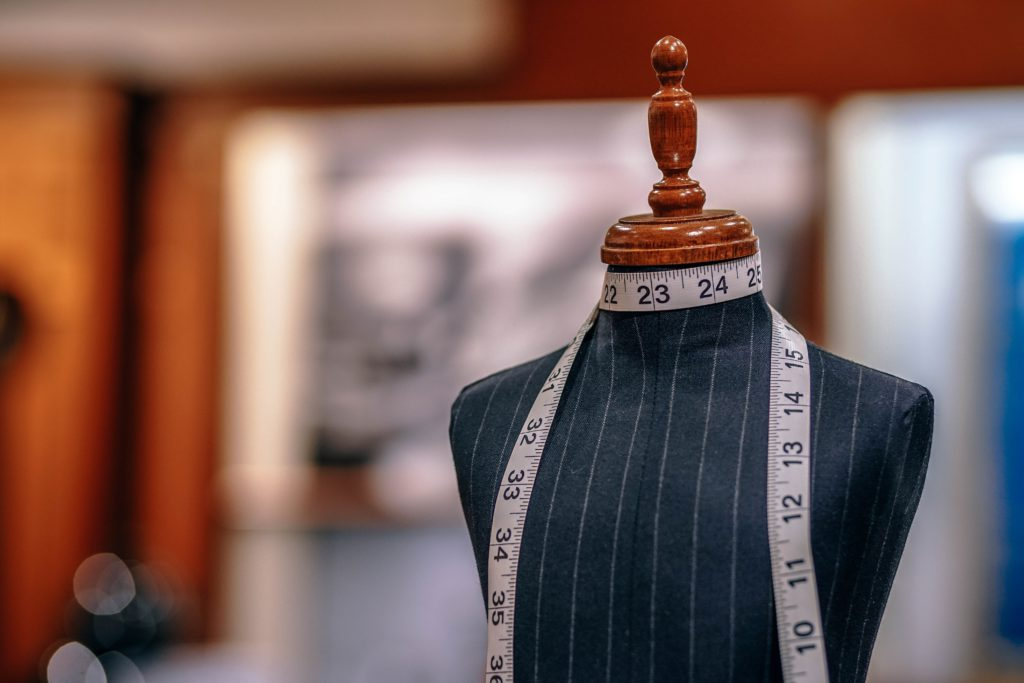 Tailor's dummy with measuring tape around neck