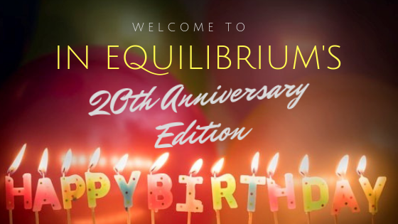 Lighted letter candles spelling out Happy Birthday with the words Welcome to In Equilibrium's 20th Anniversary Edition written above