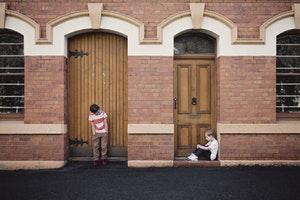 Young boys in doorways