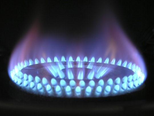 Close up photo of a gas hob burning blue