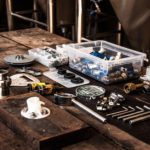 An assorted mechanical toolkit neatly laid out on a wooden workbench.