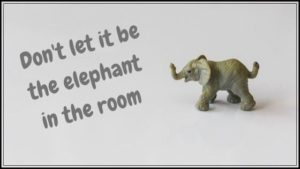 "A model elephant with the words ""Don't let it be the elephant in the room"""