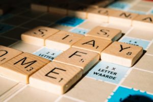 Letter tiles on board game spelling out stay safe for suicide awareness training availability