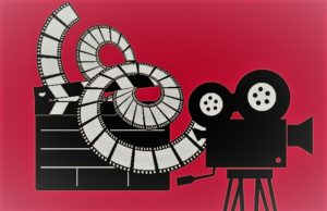 cinema image of projector with a spiral of film on a pink background for resilience tips