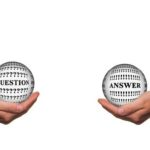Two hands with a transparent ball cupped in each, one with the word Question and the other Answer; for Ask the Expert: How can team spirit be improved when working remotely?