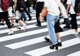 People walking on a busy zebra crossing for returning to work: anxiety management and agoraphobia training course