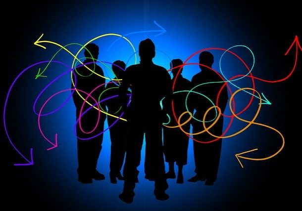 Silhouettes of a group of people with colourful feedback arrows all around them