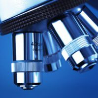 Microscope detail against blue background
